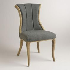 Boasting a shapely silhouette with deep vertical channels in the backrest, our exclusive charcoal gray dining chairs are a sophisticated update to traditional design. These modern classics are crafted of oak with distressed legs and smooth linen-blend upholstery.