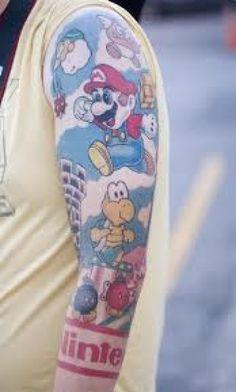 50 Best Gamer Tattoo Designs and Ideas - Beste Tattoo Ideen Gamer Tattoos, Cartoon Tattoos, Tattoos For Guys, Tatoos, Key Tattoos, Nintendo Tattoo, Gaming Tattoo, Super Mario Tattoo, Super Mario Bros