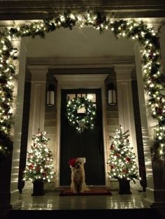 Christmas Entry Way. I love this ♥ I could do this but would have cords all over, where do they put all the cords lol, guess I could get the battery lights but the strands are usually short for wreaths
