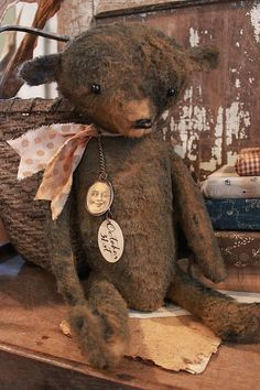 "cinnamon creek dry goods | OCTOBER BEARS (2015) ""Ezra""    Nice size bear.... sitting 10'' high. His tags are paper covered metal .         68.00 plus shipping  SOLD"