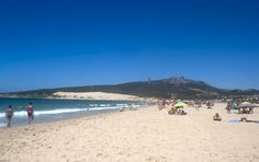 When it gets hot, Spaniards head for the warmth of the sandy beaches and the soothing waters!