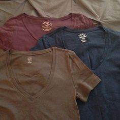 V-neck Tee Bundle Bundle of 3 V-neck tees. Slim fit with super soft stretch T-shirt material. Maroon and Navy are from Old Navy- size medium. Brown is from Gap- size S. Fit is similar on all 3. Minimal fading from wear on all. Small stain on brown tee (as pictured). Priced accordingly. GAP Tops Tees - Short Sleeve