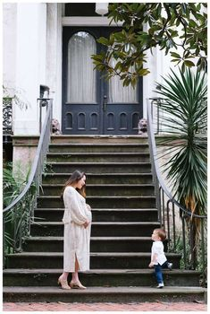 Mother and son in front of Alex Raskins antiques. Downtown Savannah Georgia family photos photographed by Kristen M. Brown of Samba to the Sea Photography. #savannah #savannahga #familyphotos