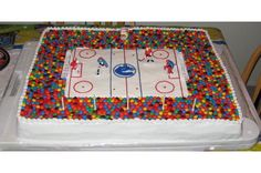 Hockey Cake - I made this cake for my sons birthday. It is four 13X9s for the hockey rink, and the spectators stand was moulded out of 18 batches of rice krispie squares. I filled the cakes with a rootbeer flavoured frosting. He loved it!