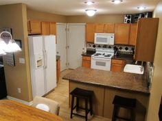 Kitchen has new backsplash, counter tops, and sink. Large breakfast bar has plenty of room for serving dishes.