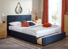 With a stunning blue fabric upholstery, the Cruz bed frame is on trend with the latest retro fashion.