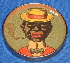 ANTIQUE DEXTERITY PUZZLE CIRCA 1920 WITH MIRRORED BACK - AFRICAN AMERICAN GENTLEMAN SMOKING £110 (ID: 10743) A fine example of a post World War One hand-held dexterity puzzle. Probably made in Germany around 1920, the puzzle has no maker's name or country of origin. This was not unusual. Following the Second World War, German goods were often marked as 'foreign'.