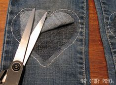 Cute way to patch jeans - make the hole bigger with a design that looked intentional.