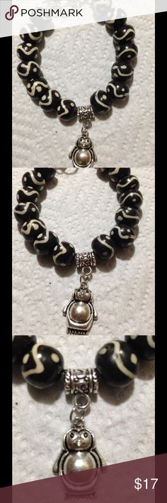 "Black and White Penguin Bracelet This cute bracelet is made with black and white ceramic beads and a silver tone penguin. It measures 8"" long. All PeaceFrog jewelry items are made by me! Take a look through my boutique for coordinating jewelry and more unique creations. PeaceFrog Jewelry Bracelets"