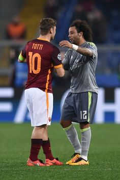 Real Madrid's Brazilian defender Marcelo is congratulated by Roma's forward Francesco Totti at the end of the UEFA Champions League football match AS Roma vs Real Madrid on Frebruary 17, 2016 at the Olympic stadium in Rome.