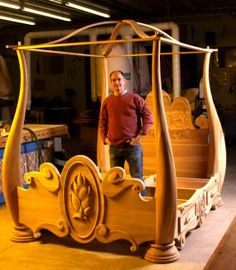 Marc Adams with his Beauty and the Beast bed. Each sinuous post started as a huge poplar glue-up, and was finished with a rasp.Marc owns and runs the largest woodworking school in North America and its where I spend at least one week a year! Woodworking School, Woodworking For Kids, Woodworking Bed, Woodworking Projects, Woodworking Workshop, Woodworking Videos, Beauty And The Beast Bedroom, Casa Disney, Disney Bedrooms