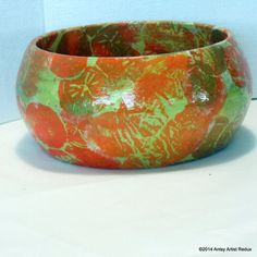 Bring the tropics home with this Florida Kumquat Bowl. it is a small wood bowl that is embellished with orange and gold kumquats which were printed