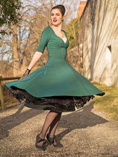 RetroCat wearing a swing dress