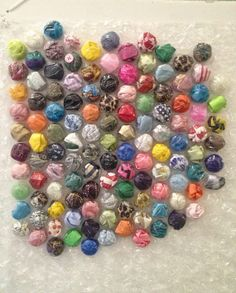 The Bubble Wrap ProjectWho knew how beautiful filling bubble wrap with fabric and ribbon would be? Perfect for nifty little fingers! The children have been apt with cutting fabric and ribbon, then stuffing it into bubble wrap pockets. Its a CAREFUL...