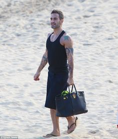 Marc Jacobs, creative Director of Louris Vuitton was seen carrying a black Hermes birkin at the beach