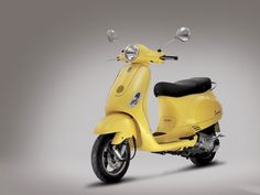 Vespa LX 125 Yellow Color Insurance Info Scooter Pictures