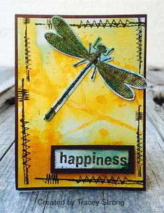 ATC by Tracey Strong using Darkroom Door Wildflowers Vol 1 Rubber Stamps (dragonfly), All Occasions Rubber Stamps (happiness) and Stitched Christmas Rubber Stamps (stitches).