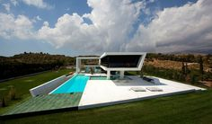 House by 314 Architecture Studio. In Athens, Greece, 314 Architecture Studio completed this interesting futuristic residence. It was designed in order to give the sense of sailing, speed and hovering over the water. Architecture Résidentielle, Contemporary Architecture, Contemporary Design, Minimalist Architecture, Best Modern House Design, Modern Design, Futuristic Home, Beautiful Homes, Swimming Pools