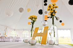 A Yellow & Gray Farm Celebration - daisy centerpieces with gray, yellow and white chinese lanterns