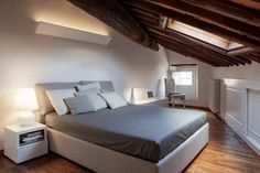 Gorgeous master bedroom with a slanted ceiling Attic Bed, Master Bedroom, Bedroom Decor, Slanted Ceiling, Loft Stairs, Attic Design, Apartment Renovation, Contemporary Style, Interior Inspiration