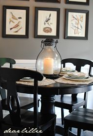 black kitchen table with black frames on grey walls.  i like this look