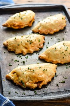 Ground Beef Empanadas surrounded by cheese and wrapped in flaky pie dough are a fun and satisfying dinner or lunch!
