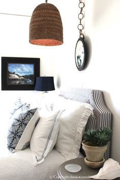 nice layering on the bed - classic and crisp. love that stripe headboard!