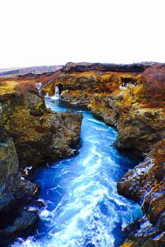 Hraunfossar - series of waterfalls formed by lava (Hraun = lava)... Flows into Hvita river finally. Close to Reykholt