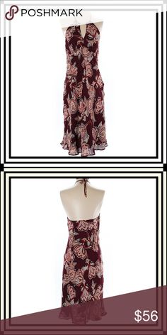 "Ann Taylor LOFT Dress This beautiful Ann Taylor LOFT silk dress features cut out details and a gorgeous print on a burgundy background. Measures 30"" Chest and 30"" length. In exceptional pre-loved condition. No flaws. Size 4. Perfect for any summer outing. 100% Silk. Ann Taylor LOFT Dresses Midi"