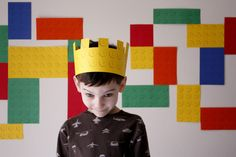 FREE Printable - entire 8 1/2 x 11 sheet of Lego bumps. I printed up a couple of sheets of each color, cut them into bricks and used them to make my Lego mosaic wall. You can use them for bunting, for napkin rings, for invitations, for a crown like I did here...