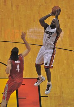 LeBron James shoots. Miami Heat beat the Houston Rockets, 125-119, at American Airlines Arena in Miami, Fla. 3-27-11