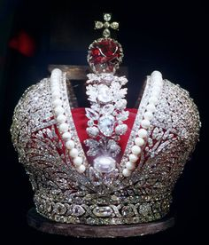The Great Imperial Crown, made by a skilled court jeweller, Jeremia Posier, for the Empress Catherine II the Great's Coronation in 1762. Made up of the two open hemispheres divided by a foliate garland and fastened with a low hoop. The crown is set with 5,000 selected Indian diamonds (some Russian sources state this number as 4,836) & large white pearls. The crown is also decorated with one of the seven historic stones of the Russia's Diamond Collection -a large red spinel weighing 398.72 carats