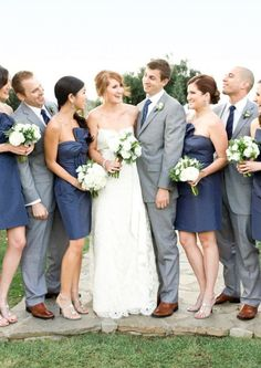 Navy maids Calvin Klein wedding suit white and green bouquets...Add a touch of coral to the bouqets to really make them stand out!