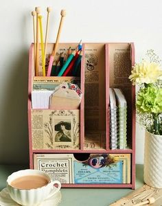 What a great idea! I love the old magazines decoupaged in this desk organizer.