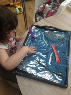 Salt, dyed with food colouring and silver glitter added - put on a tin foil lined tray and it became our moon dust :) We even added some to ice cubes to watch them melt and make coloured glittery water x