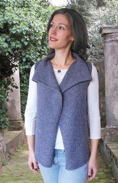 This one-piece vest with a 3-stitch rolled edge down left and right front and around armholes, is worked top-down from the shoulders in Stocking stitch.