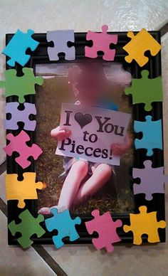 I bought a 100 piece puzzle. Hand painted them with acrylic paint. Hot glued them to a picture frame. The picture, i took in my yard after i had made a quick sign on cardstock using my cricut to cut out the letters. Gave to grandmas/aunt for mothers day this year. Thought it made an awesome keepsake and nice to display at work:)