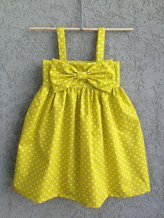 White Pin Dot on Citron Yellow baby/toddler dress, 100% Organic Cotton. $65.00, via Etsy.