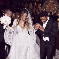 """Ciara and Russell Wilson have tied the knots in a fairy tale-like ceremony. The singer captioned the pic: """"We are The Wilsons!"""" Get the details!"""