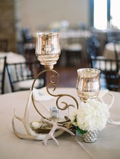 Rustic elegant wedding centerpiece idea - mix of natural, rustic elements like antlers and flowers + glam mercury glass votives {Charla Storey Photography}