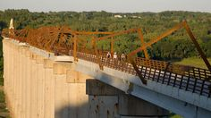 Take in the awe-inspiring view of the Des Moines River Valley from the High Trestle Trail Bridge. The bridge is located in central Iowa near the town of Madrid, and is the centerpiece of a 25-mile trail that runs from the cities of Ankeny to Woodward. At 2,300 feet long and 13 stories tall, it is the fifth largest trail bridge in the world.