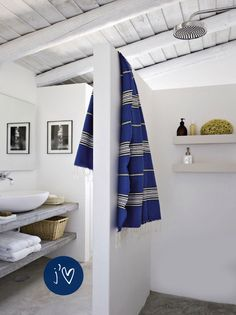 Downstairs bathroom. Love the open shelving for a guest bathroom.