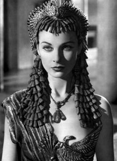 The closer to the final confrontation, the less simplicity & the more layering of scales, plates etc to define glamorous, rich beauty. Also serves as metaphor.  (Vivien Leigh as Cleopatra)