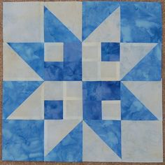 so pretty yet soo simple. Blue and white star quilt block