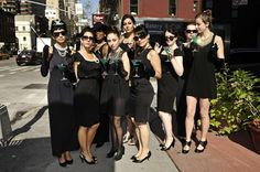 Breakfast at Tiffany's theme hen-do. Black dresses, pearls, tiara's and long gloves..