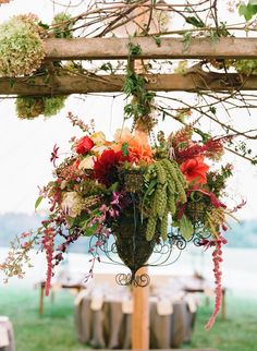 Hanging centrepiece Tented Wedding Reception -- Love all the florals!! See lots more on SMP: http://www.StyleMePretty.com/mid-atlantic-weddings/2014/03/18/outdoor-blue-ridge-mountains-fall-wedding/ Jen Fariello Photography | Southern Blooms By Pat's Floral Designs
