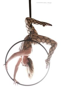 Don Curry Photography Lyra, Aerial Hoop, Photoshoot I love how it looks like there isn't a part of her body that's actually holding her weight