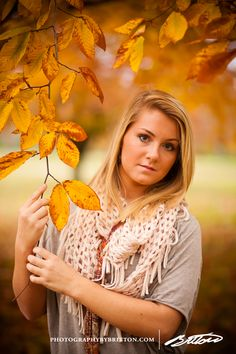Holding a tree branch beside her face added for the coolest fall framing. Stoked about this idea I had! www.photographybybritton.com