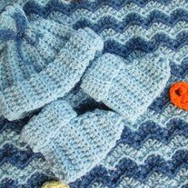 Baby Boy's Blue Blanket, Hat, and Booties Set  *The fish completely make this blanket!*  I thought the pattern on this blanket turned out to look a lot like water, so I was inspired to add the fish.  The hat is newborn size, and the booties have a four inch sole.  Always handmade with lov...