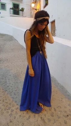 Not only does she look super cute, it looks like she is in Greece or some Mediterranean island which makes me really envy her.